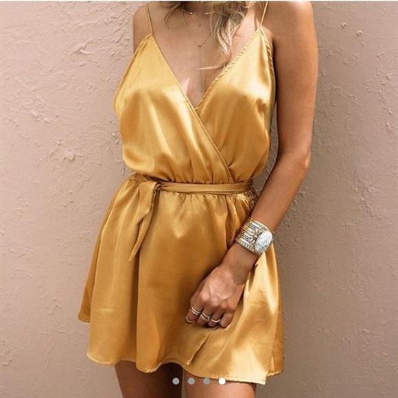 Sabo Skirt Dresses & Skirts - ❌sold❌Sabo Skirt Golden Deep plunge romper NWT